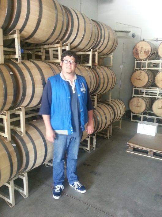 Dan in front of barrels of Grand Traverse Whiskey