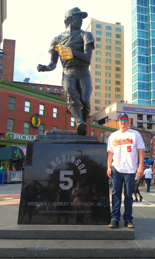 In front of the Brooks Robinson statue